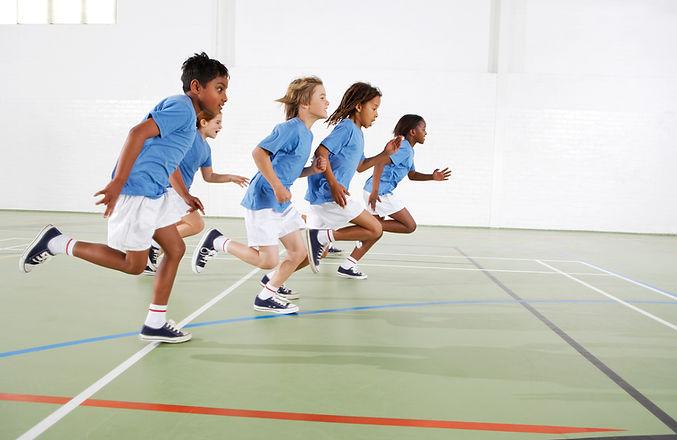 Kids Running in gymnasium