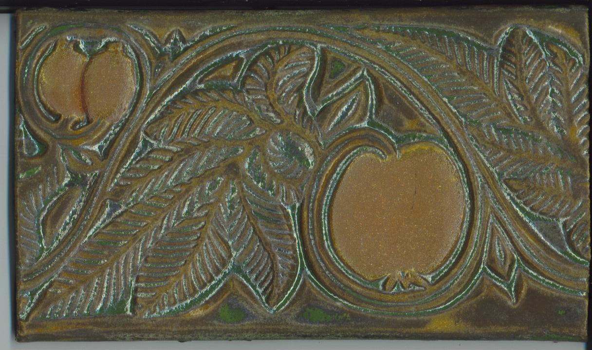 Tile with pomegranate design