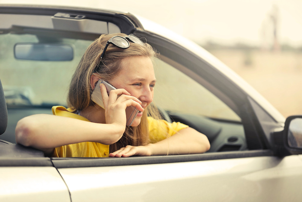 Woman Smiling in Car on the Phone