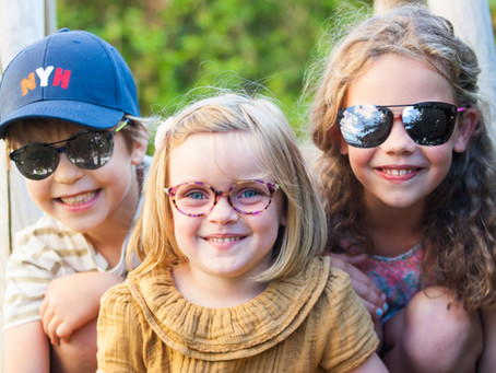 Why do children wearing spectacles need sunglasses?
