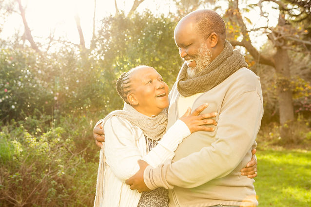 happy-peaceful-senior-couple-embracing-i