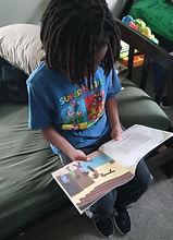 6-28-21 boy reading 1_edited.jpg