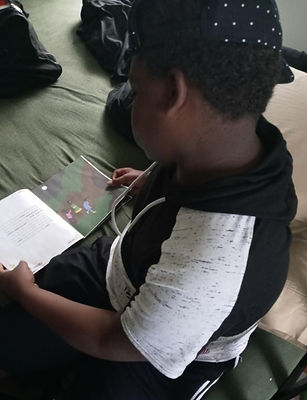 6-28-21 boy reading 2_edited_edited.jpg