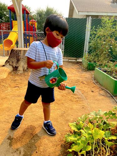Fun in the Garden watering the crops.jpg