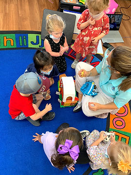 Preschool little students learning spani