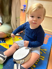 Toddlers learning about music and rythm.