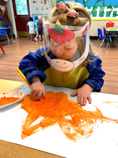 Fairmont preschool student painting and