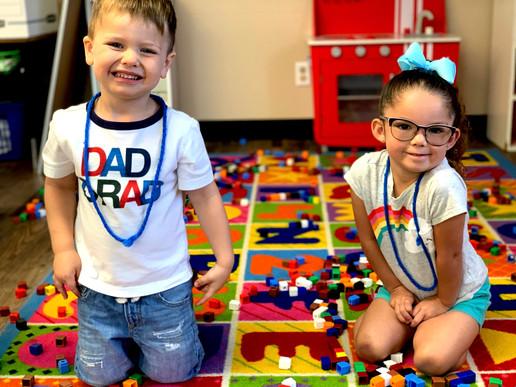 Kindergarten students playing with legos