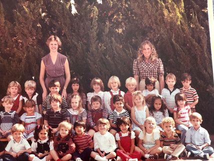 Kathy with children graduating in the 19