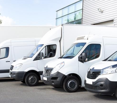 Canva - Several cars vans trucks parked