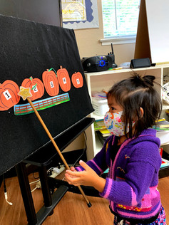 Preschool girl learning to count to 5.jp