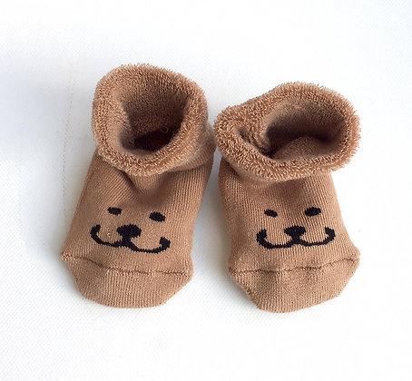 Babysocken mit Bärengesicht
