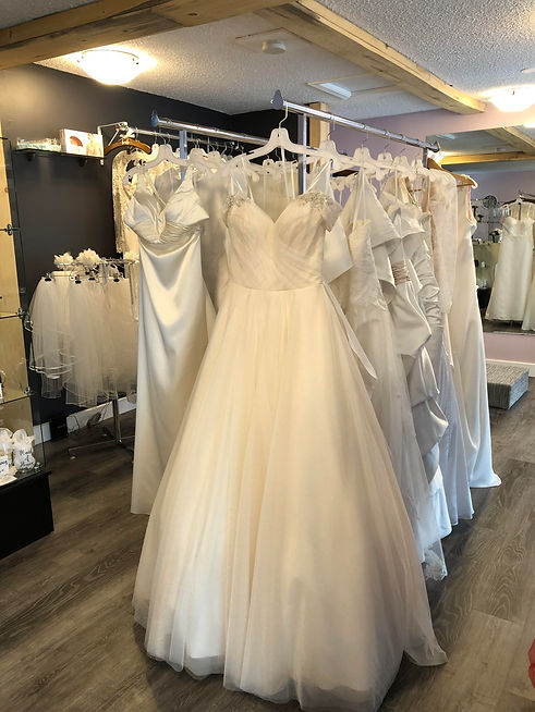 wedding dresses on racks 2.jpg