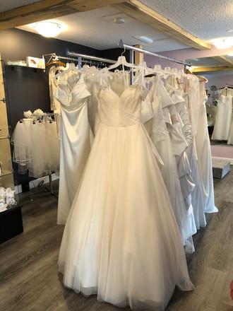wedding dresses on racks 2.jpg