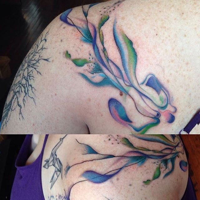 Fun abstract watercolor tattoo