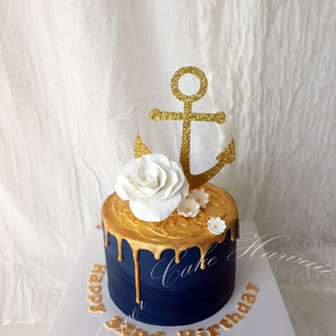 Navy and Gold Drip Cake
