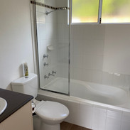 Second Bathroom with a bath shower combination