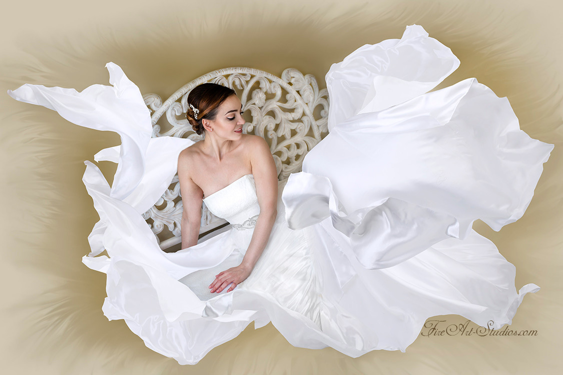 Artistic bridal portrait with flying fabric