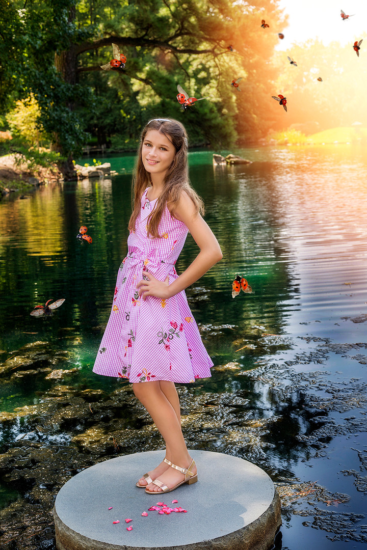 Fine Art children portraits with photo manipulation and compositing. A teenage girl on a lake.