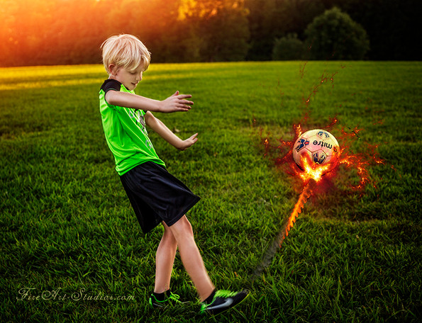 Fine Art children portraits with photo manipulation and compositing. Conceptual sport photography. A boy with a soccer ball.