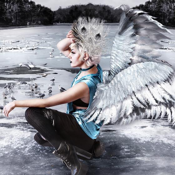 Swan girl on a frozen lake