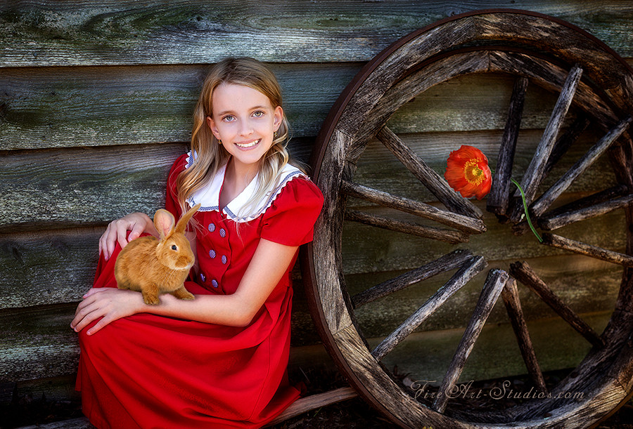 Fine Art children portraits with photo manipulation and compositing. A girl with a rabbit and a poppy.