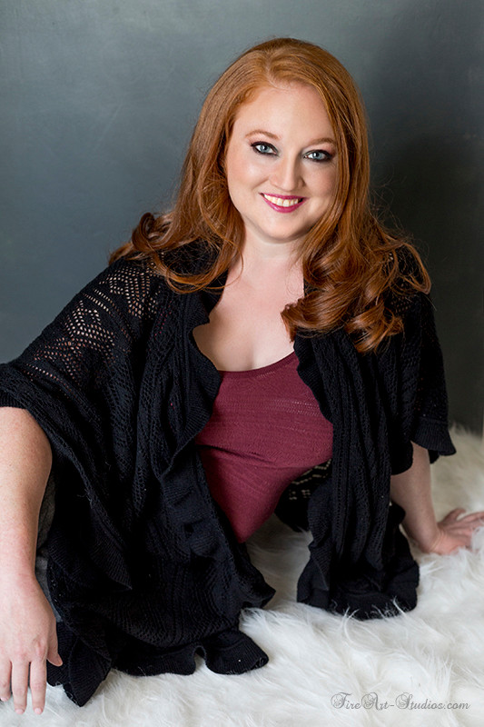 Beautiful redhead girl. Studio portrait.
