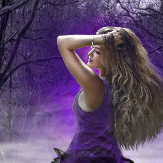 Beautiful girl in purple in the haunted forest