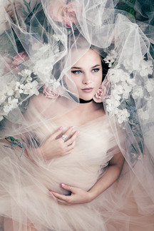 Dreamy bridal glamour portrait with flowers.