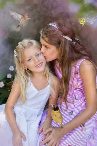 Family & Children photography. Outdoor shoot with adding texture and birds. Sisters' love.