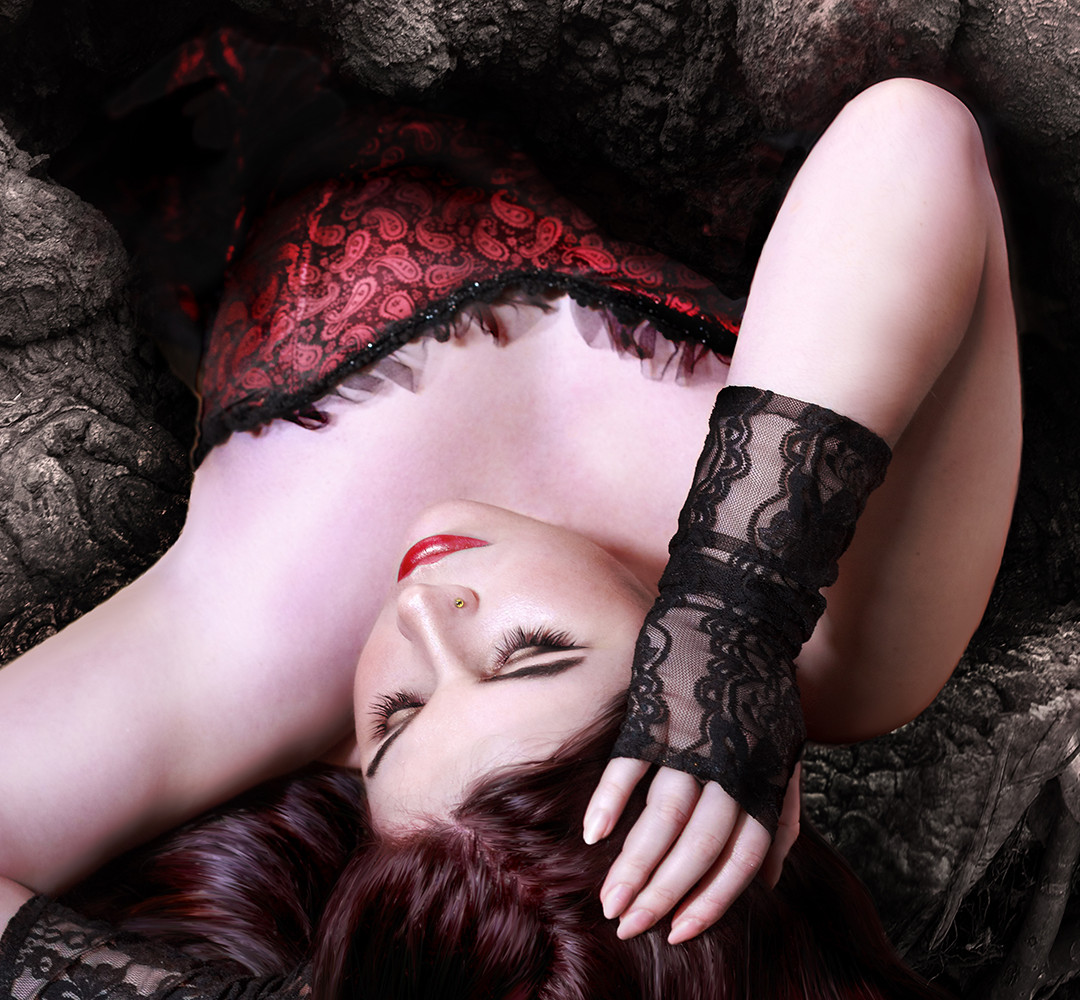 Girl in red lying down