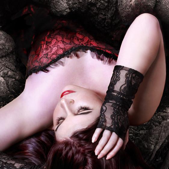 Girl in red lying down