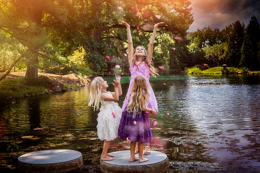 Children photography. Outdoor shoot with artistic effects. Sisters playing.