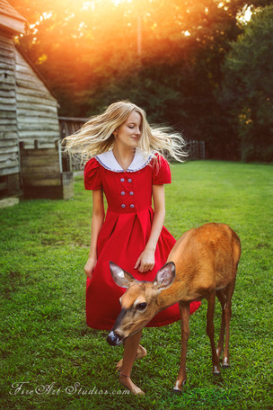 Fine Art children portraits with photo manipulation and compositing. A teenage girl with a deer.