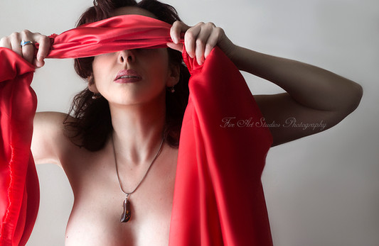 Lady with a red blindfold.