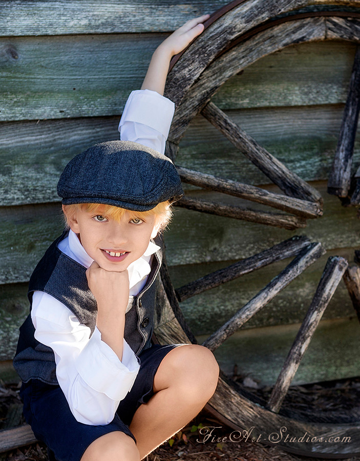 Children photography. Sunset outdoor shoot with vintage flair. Retro boy at the farm.