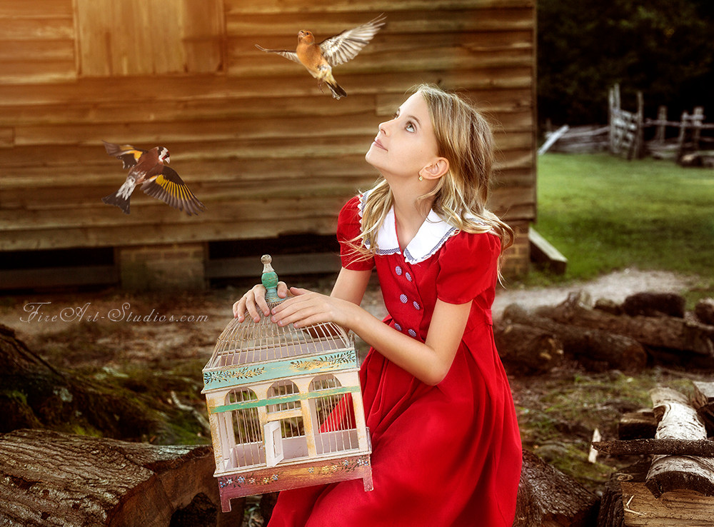 Fine Art children portraits with photo manipulation and compositing. A teenage girl with a bird cage and birds flying free.