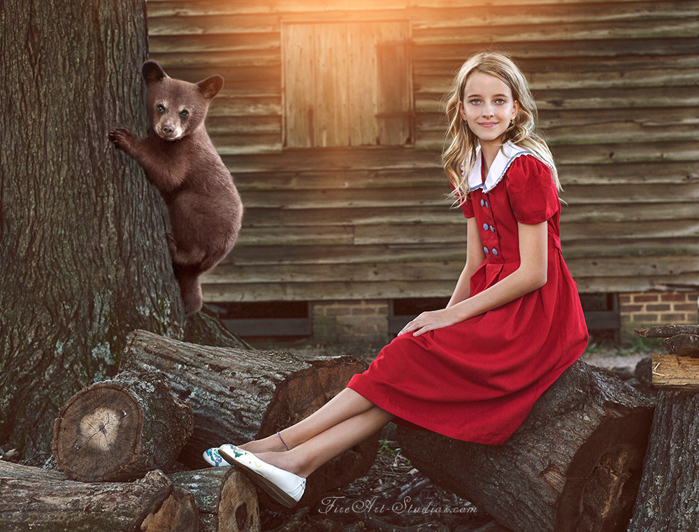 Fine Art children portraits with photo manipulation and compositing. A teenage girl with a bear cub.