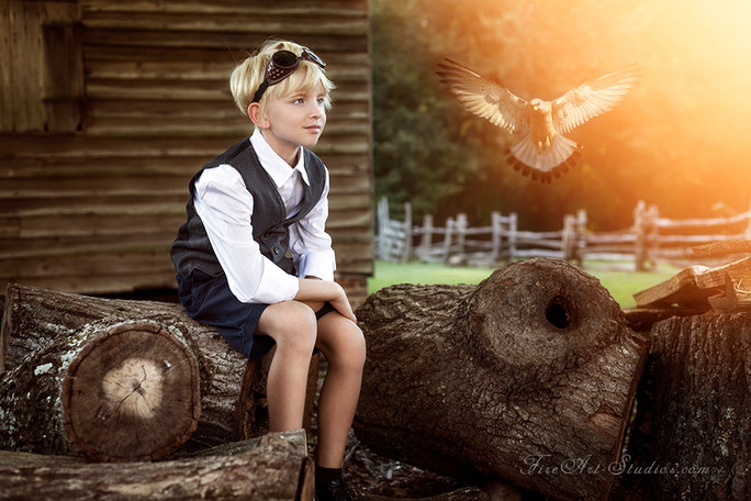 Fine Art children portraits with photo manipulation and compositing. A vintage steampunk fantasy with a boy and an eagle.