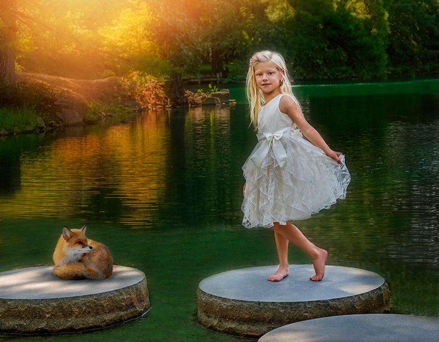 Fine Art children portraits. A young girl with a fox.