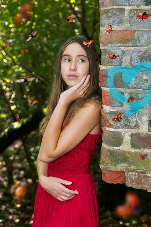 Fine Art children and senior portraits with fashion and artistic flair. A girl with lady bugs.