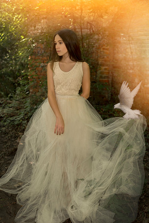 Fine Art senior and children portraits with photo manipulation and compositing. Ethereal portrait of a young lady with a bird.