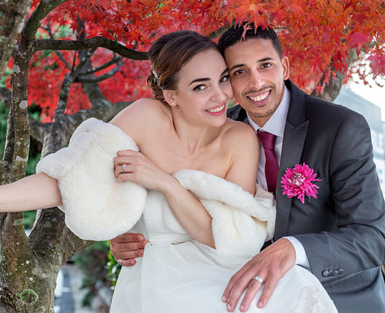 Young couple under the red tree