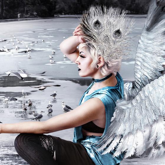 Beautiful girl. White winter bird