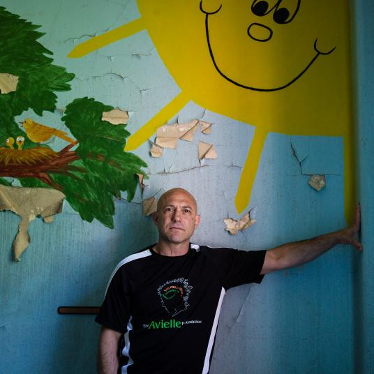 Jeremy Richman, father of Sandy Hook shooting victim Avielle Richman, stands as if he's propping up a big, smiling sun.
