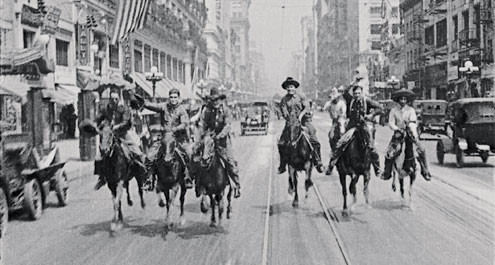 Cowboys riding through New York (actually downtown Los Angeles) in Bucking Broadway (1917)