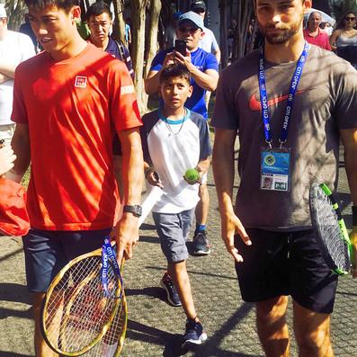 Brandon Larsen and Kei Nishikori walking to tennis practice