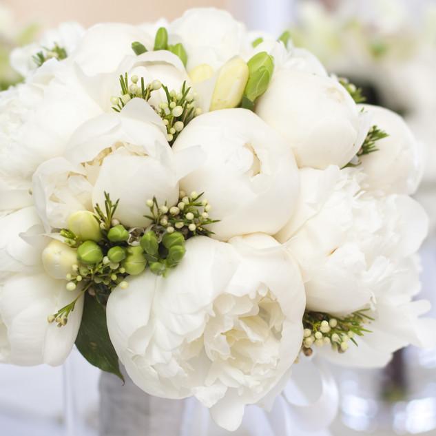 White wedding bouquet in vase.jpg