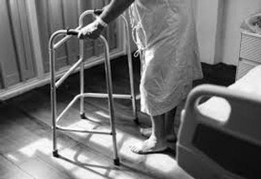 Elderly person with walker.jpg