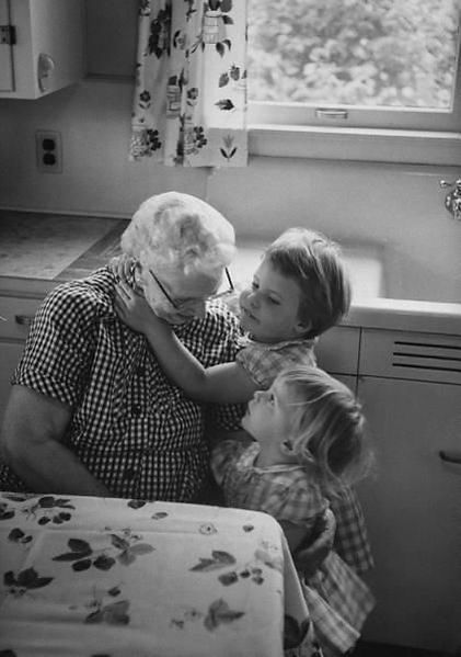 caregiving - children hugging grandmothe